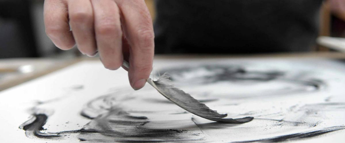 Tansy drawing with a feather and charcoal powder