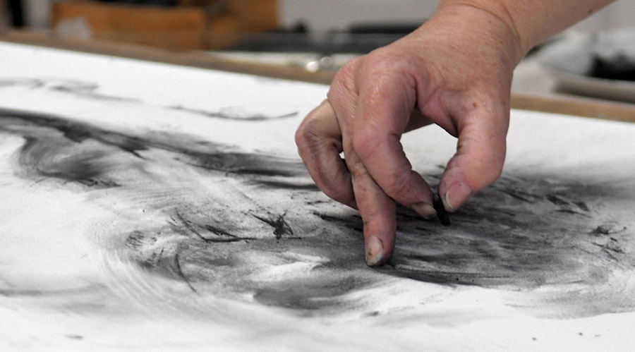 Tansy Lee Moir drawing with charcoal