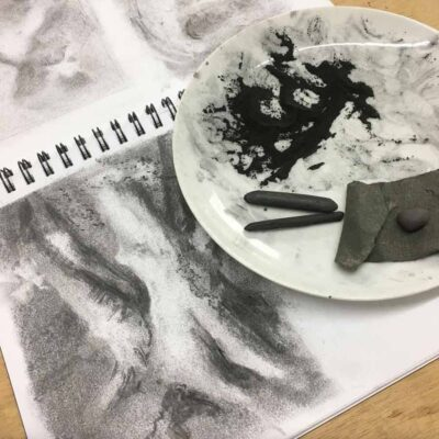 charcoal drawing of a tree with plate containing charcoal